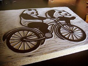 Panda Linocut Test Inking - Pandas on a bicycle