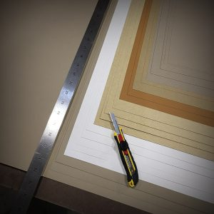 Hand cutting paper with a straight edge